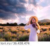 Portrait of a beautiful blonde woman standing among the plantations... Стоковое фото, фотограф Zoonar.com/OKSANA SHUFRYCH / easy Fotostock / Фотобанк Лори