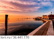 Romantic sunset on the Venice lagoon. Island of Pellestrina and town. Стоковое фото, фотограф Zoonar.com/Franco Nadalin / easy Fotostock / Фотобанк Лори