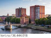 Kaliningrad street view with the Jubilee Bridge. Редакционное фото, фотограф EugeneSergeev / Фотобанк Лори