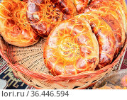Fresh uzbek flatbread with sesame seeds from the tandoor. Traditional... Стоковое фото, фотограф Zoonar.com/Alexander Blinov / easy Fotostock / Фотобанк Лори