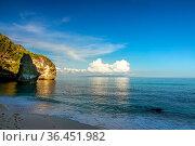 Indonesia. Evening on an empty shady beach on a tropical island. The... Стоковое фото, фотограф Zoonar.com/Mikhail Pavlov / easy Fotostock / Фотобанк Лори
