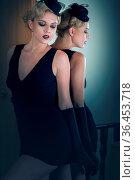Retro portrait of a beautiful woman next to mirror. Vintage Style. Стоковое фото, фотограф Zoonar.com/Svetlana Radayeva / easy Fotostock / Фотобанк Лори
