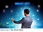 Concept of smart city with businessman pressing buttons. Стоковое фото, фотограф Zoonar.com/Elnur Amikishiyev / easy Fotostock / Фотобанк Лори