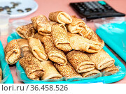 Appetizing fried pancakes during Pancake Week. Russian traditional... Стоковое фото, фотограф Zoonar.com/Alexander Blinov / easy Fotostock / Фотобанк Лори