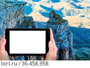 Travel concept - tourist photographs of old rocks of Bermamyt Plateau... Стоковое фото, фотограф Zoonar.com/Valery Voennyy / easy Fotostock / Фотобанк Лори