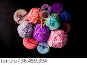 Top view heap of plush and textile yarn balls with knitting needles... Стоковое фото, фотограф Zoonar.com/Oksana Shufrych / easy Fotostock / Фотобанк Лори