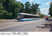 City street scene with tramway in Moscow, modern environmental transport: Moscow, Russia - May 26, 2021. Редакционное фото, фотограф Алексей Голованов / Фотобанк Лори