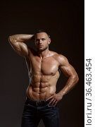 Male athlete with muscular body poses in studio. Стоковое фото, фотограф Tryapitsyn Sergiy / Фотобанк Лори