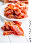 Dried chicken meat. Tasty jerky meat on white table. Стоковое фото, фотограф Zoonar.com/JIRI HERA / easy Fotostock / Фотобанк Лори