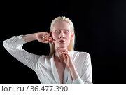 Young blonde albino woman doing face building facial gymnastics self... Стоковое фото, фотограф Zoonar.com/Max / easy Fotostock / Фотобанк Лори