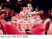 Romantic dinner pink decor table at restaurant. Стоковое фото, фотограф Zoonar.com/Max / easy Fotostock / Фотобанк Лори