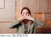 Business woman young adult coach at office close mouth with hands... Стоковое фото, фотограф Zoonar.com/Max / easy Fotostock / Фотобанк Лори