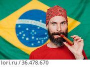 Bearded man in bandana against Brazilian flag background. Стоковое фото, фотограф Zoonar.com/Max / easy Fotostock / Фотобанк Лори