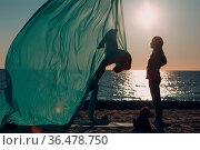 Air yoga on the beach. Healthy Woman. Стоковое фото, фотограф Zoonar.com/Max / easy Fotostock / Фотобанк Лори