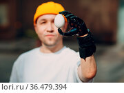 Young disabled man holding fragile chicken egg with artificial prosthetic... Стоковое фото, фотограф Zoonar.com/Max / easy Fotostock / Фотобанк Лори