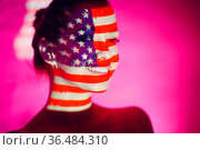 Young woman smiling with USA flag on her face. Стоковое фото, фотограф Zoonar.com/Max / easy Fotostock / Фотобанк Лори