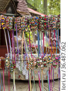 Handmade flower and ribbon garlands are offered for sale at an outdoor... Стоковое фото, фотограф Lori Epstein / age Fotostock / Фотобанк Лори
