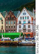 Bergen, Norway - July 30, 2018: City street view with Bryggen hanseatic... Стоковое фото, фотограф Zoonar.com/Nataliya_Nazarova{} / age Fotostock / Фотобанк Лори