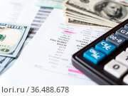 Business and financial background with dollars, charts, pen and calculator... Стоковое фото, фотограф Zoonar.com/BASHTA / easy Fotostock / Фотобанк Лори