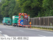 Highway scenery including a mobile traffic sign in Germany at summer... Стоковое фото, фотограф Zoonar.com/Achim Prill / easy Fotostock / Фотобанк Лори