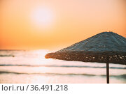 Close Up Umbrella On Sandy Beach. Sun Sunshine Above Wicker Umbrella... Стоковое фото, фотограф Ryhor Bruyeu / easy Fotostock / Фотобанк Лори