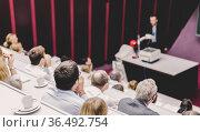 Professor giving presentation in lecture hall at university. Стоковое фото, фотограф Matej Kastelic / Фотобанк Лори