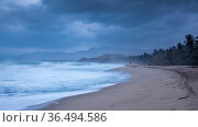Jogger in distance on Playa Naranjos and the Caribbean Coast at dawn, Magdalena, Colombia. Стоковое фото, фотограф David Noton / Nature Picture Library / Фотобанк Лори