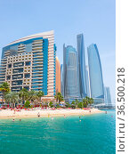 Abu Dhabi, UAE - April 1. 2019. Beach and Khalidiya Palace Rayhaan by Rotana hotel and and Etihad Towers. Редакционное фото, фотограф Володина Ольга / Фотобанк Лори