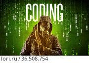 Faceless hacker with CODING inscription, hacking concept. Стоковое фото, фотограф Zoonar.com/ranczandras / easy Fotostock / Фотобанк Лори