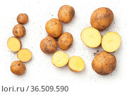 Fresh organic potatoes isolated on white background. Top view. Стоковое фото, фотограф Zoonar.com/Bozena Fulawka / easy Fotostock / Фотобанк Лори