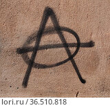 Symbol of Anarchy painted on a wall. Стоковое фото, фотограф Zoonar.com/Claudio Divizia / easy Fotostock / Фотобанк Лори