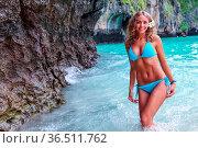 Beautiful woman in bikini on beach at Maya bay, Thailand. Стоковое фото, фотограф Zoonar.com/Ivan Mikhaylov / easy Fotostock / Фотобанк Лори