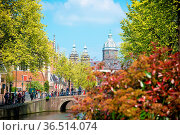 Bridge, canal and St. Nicolas Church in Amsterdam. Amsterdam is the... Стоковое фото, фотограф Zoonar.com/Yuri Dmitrienko / easy Fotostock / Фотобанк Лори