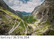 Trollstigen, Andalsnes, Norway. Cars Goes On Serpentine Mountain Road... Стоковое фото, фотограф Ryhor Bruyeu / easy Fotostock / Фотобанк Лори