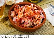 Pig ears with paprika in bowl. Стоковое фото, фотограф Яков Филимонов / Фотобанк Лори