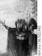 Mutant creature at religious ceremony. Стоковое фото, фотограф Евгений Ткачёв / Фотобанк Лори