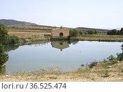 Alacon, pond and hermitage of San Miguel (XVII century). Andorra-... Стоковое фото, фотограф J M Barres / age Fotostock / Фотобанк Лори