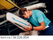 Sportsman single scull man rower prepare to competition boat regatta... Стоковое фото, фотограф Zoonar.com/Max / easy Fotostock / Фотобанк Лори