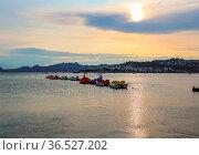 Beautiful sunset on Aegean coast with islands and mountains, boats... Стоковое фото, фотограф Zoonar.com/Volha Halkouskaya / easy Fotostock / Фотобанк Лори