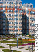 Krasnogorsk, Russia - July 22. 2021. Walking area with a children's playground on the embankment (2000 год). Редакционное фото, фотограф Володина Ольга / Фотобанк Лори