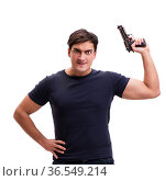 Aggressive young man with gun isolated on white. Стоковое фото, фотограф Elnur / Фотобанк Лори