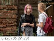 Two teenage girls are secret in the courtyard of an old house. Стоковое фото, фотограф Евгений Харитонов / Фотобанк Лори