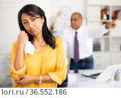 Woman crying standing in office with director behind. Стоковое фото, фотограф Яков Филимонов / Фотобанк Лори