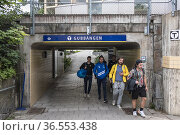 Stockholm, Sweden People walking in the underpass to the Gubbangen... Редакционное фото, фотограф A. Farnsworth / age Fotostock / Фотобанк Лори