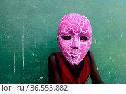 Portrait of masked person at carnival, Eticoga, Orango Island, Bijagos UNESCO Biosphere Reserve, Guinea Bissau, February 2015. Стоковое фото, фотограф Enrique Lopez-Tapia / Nature Picture Library / Фотобанк Лори