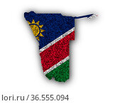 Karte und Fahne von Namibia auf Mohn - Map and flag of Namibia on... Стоковое фото, фотограф Zoonar.com/lantapix / easy Fotostock / Фотобанк Лори