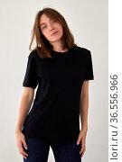 Peaceful woman in black t shirt in studio. Стоковое фото, фотограф Ekaterina Demidova / Фотобанк Лори