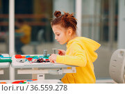 Little girl child with constructor checking technical toy. Children... Стоковое фото, фотограф Zoonar.com/Max / easy Fotostock / Фотобанк Лори