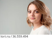 Portrait of a young attractive woman with blond hair on a neutral... Стоковое фото, фотограф Zoonar.com/BASHTA / easy Fotostock / Фотобанк Лори