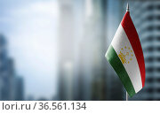 A small flag of Tajikistan on the background of an urban abstract... Стоковое фото, фотограф Zoonar.com/BUTENKOV ALEKSEY / easy Fotostock / Фотобанк Лори